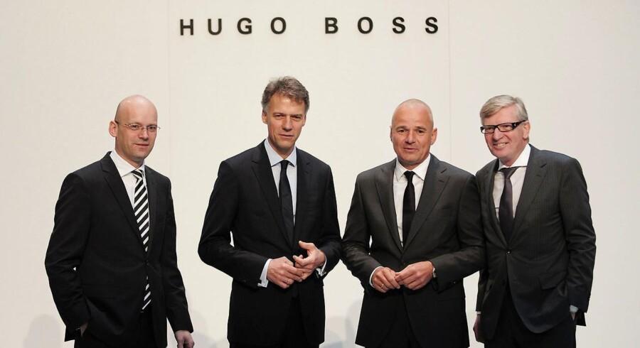 Hugo Boss udskyder udsigterne til vækst til 2018, eftersom selskabets administrerende direktør, Mark Langer, vil renovere den tyske luksuskoncern.