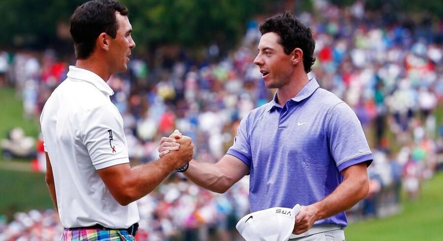 Golf er en gentlemansport, og det viser Horschel og McIlroy her, efter de har dystet om en bonus på 10 millioner dollars.