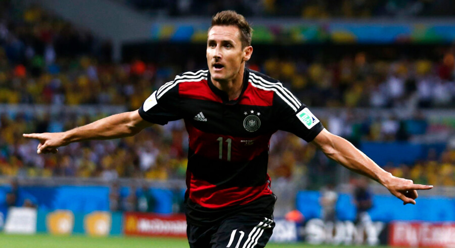 File photo of Germany's striker Miroslav Klose celebrating after scoring a goal during the 2014 World Cup semi-finals between Brazil and Germany at the Mineirao stadium in Belo Horizonte July 8, 2014. Klose, who capped a record-breaking career with the national team by winning the World Cup last month, has retired from international football. Poland-born Klose, who scored twice in the tournament in Brazil to become the competition's record goal scorer of all time with 16 goals, said August 11, 2014, the time was right to end a 13-year career with the German national team. REUTERS/Marcos Brindicci/Files (BRAZIL - Tags: SPORT SOCCER)