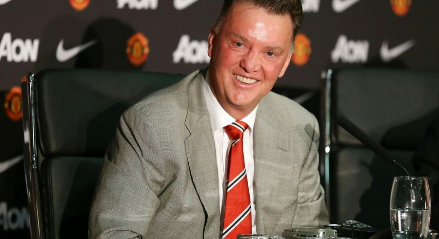 Manchester United's newly-appointed Dutch manager Louis van Gaal addresses a press conference at Old Trafford in Manchester, north-west England, on July 17, 2014. Louis van Gaal started a new era at Manchester United on Wednesday as the Dutch manager arrived for his first day in charge of the fallen giants. AFP PHOTO/LINDSEY PARNABY RESTRICTED TO EDITORIAL USE. No use with unauthorized audio, video, data, fixture lists, club/league logos or 'live' services. Online in-match use limited to 45 images, no video emulation. No use in betting, games or single club/league/player publications.