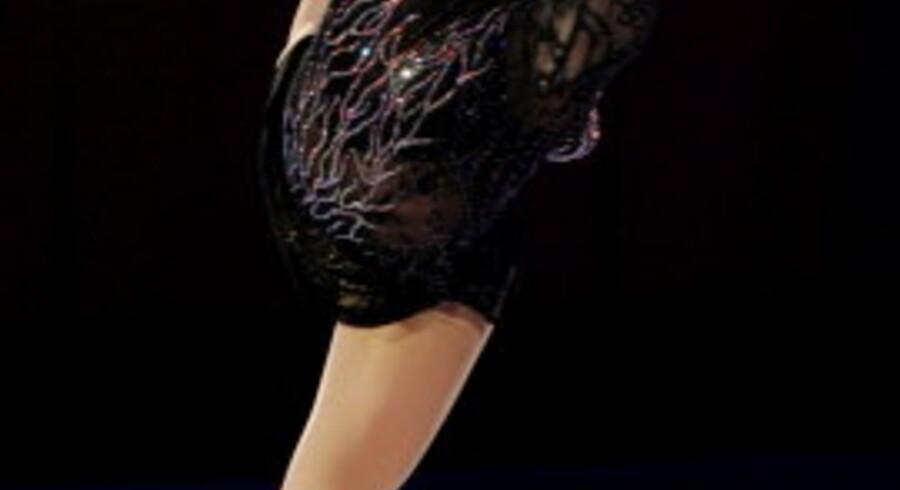 Irina Slutskaya strålede under skøjtegallaen i aftes, men kiksede da det gjaldt i kampen om guldet. Foto: Lee-Jae Won/Reuters