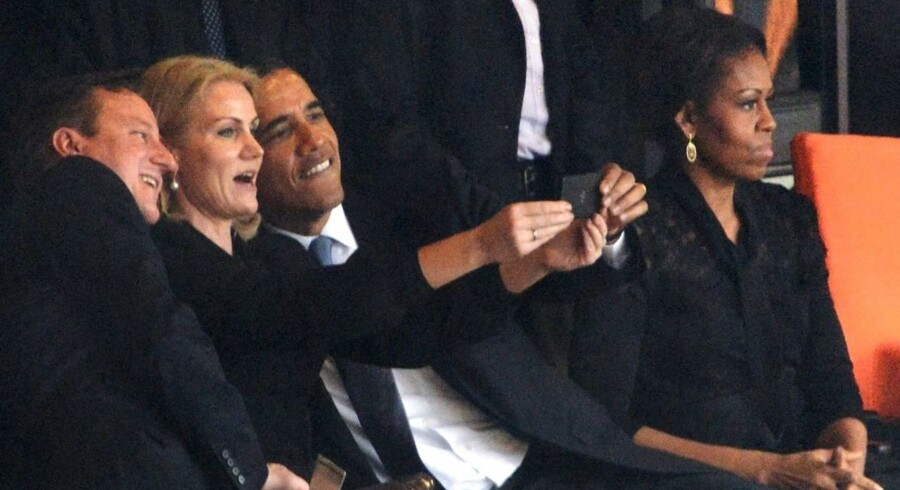- - AFP PICTURES OF THE YEAR 2013 - - US President Barack Obama (R) and British Prime Minister David Cameron pose for a selfie picture with Denmark's Prime Minister Helle Thorning Schmidt (C) next to US First Lady Michelle Obama (R) during the memorial service of South African former president Nelson Mandela at the FNB Stadium (Soccer City) in Johannesburg on December 10, 2013. Mandela, the revered icon of the anti-apartheid struggle in South Africa and one of the towering political figures of the 20th century, died in Johannesburg on December 5 at age 95. AFP PHOTO / ROBERTO SCHMIDT