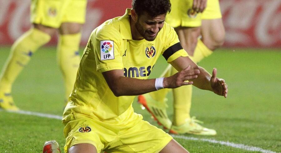 Mateo Musacchio ærgrer sig gul og mere gul efter at have lavet kampens andet selvmål, da Barcelona får udlignet og kommet på sporet af sejr.