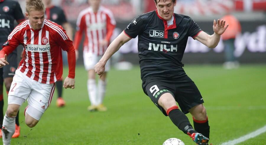 Morten 'Duncan' Rasmussen i aktion for FC Midtjylland i lørdagens Superliga-topopgør mod AaB, hvor han blev skadet.