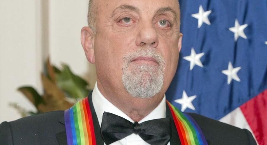 Billy Joel, da han i december 2013 modtog Kennedy Center Honors, nationens højeste udmærkelse til kunstnere, der har påvirket amerikansk kultur.