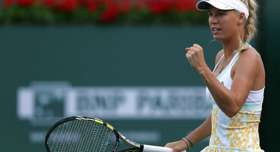 INDIAN WELLS, CA - MARCH 07: Caroline Wozniacki of Denmark celebrates after winning a point against Bojana Jovanovski of Serbia during the BNP Paribas Open at Indian Wells Tennis Garden on March 7, 2014 in Indian Wells, California. Jeff Gross/Getty Images/AFP == FOR NEWSPAPERS, INTERNET, TELCOS & TELEVISION USE ONLY ==