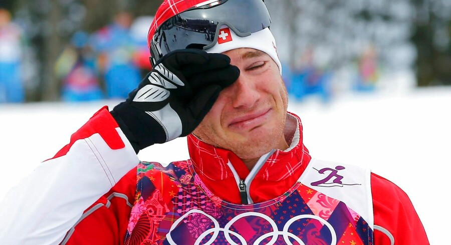 Winner Dario Cologna of Switzerland reacts during the flower ceremony for the men's skiathlon event at the Sochi 2014 Winter Olympics in Rosa Khutor February 9, 2014. REUTERS/Carlos Barria (RUSSIA - Tags: SPORT OLYMPICS SKIING TPX IMAGES OF THE DAY) ATTENTION EDITORS: PICTURE 10 OF 25 FOR PACKAGE 'SOCHI - EDITOR'S CHOICE' TO FIND ALL IMAGES SEARCH 'EDITOR'S CHOICE - 09 FEBRUARY 2014'