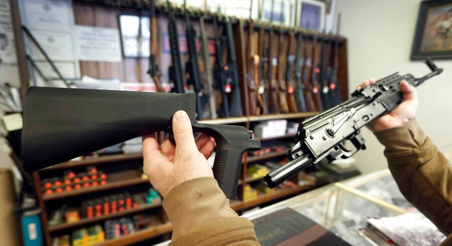 SALT LAKE CITY, UT - OCTOBER 5: A bump stock device, (left) that fits on a semi-automatic rifle to increase the firing speed, making it similar to a fully automatic rifle, is shown next to a AK-47 semi-automatic rifle, (right) at a gun store on October 5, 2017 in Salt Lake City, Utah. Congress is talking about banning this device after it was reported to of been used in the Las Vegas shootings on October 1, 2017. George Frey/Getty Images/AFP == FOR NEWSPAPERS, INTERNET, TELCOS & TELEVISION USE ONLY ==