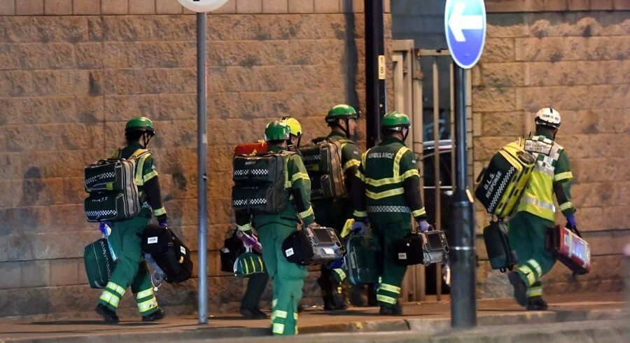 "Medics deploy at the scene of a reported explosion during a concert in Manchester, England on May 23, 2017. British police said early May 23 there were ""a number of confirmed fatalities"" after reports of at least one explosion during a pop concert by US singer Ariana Grande. Ambulances were seen rushing to the Manchester Arena venue and police added in a statement that people should avoid the area / AFP PHOTO / Paul ELLIS"