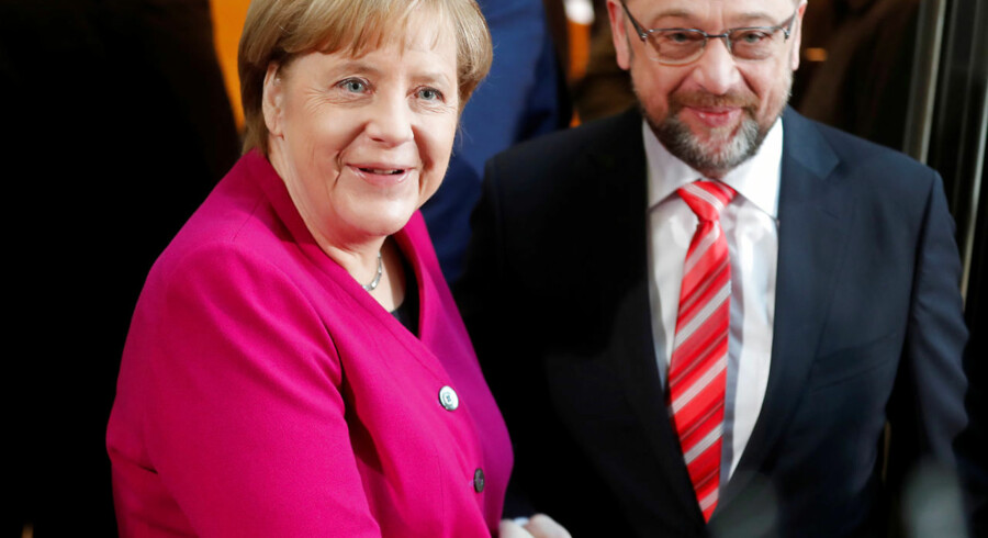 Leader of the Christian Democratic Union (CDU) and the acting German Chancellor Angela Merkel and Social Democratic Party (SPD) leader Martin Schulz shakes hands before exploratory talks about forming a new coalition government at the SPD headquarters in Berlin, Germany, January 7, 2018. REUTERS/Hannibal Hanschke