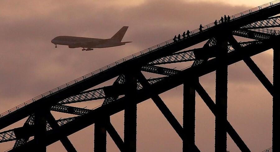 ARKIVFOTO: Et fly gør klar til landing i Sydneys internationale lufthavn.