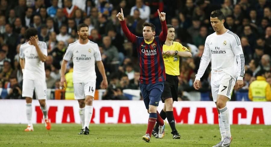 Barcelonas Lionel Messi (th) og Real Madrids Cristiano Ronaldo.