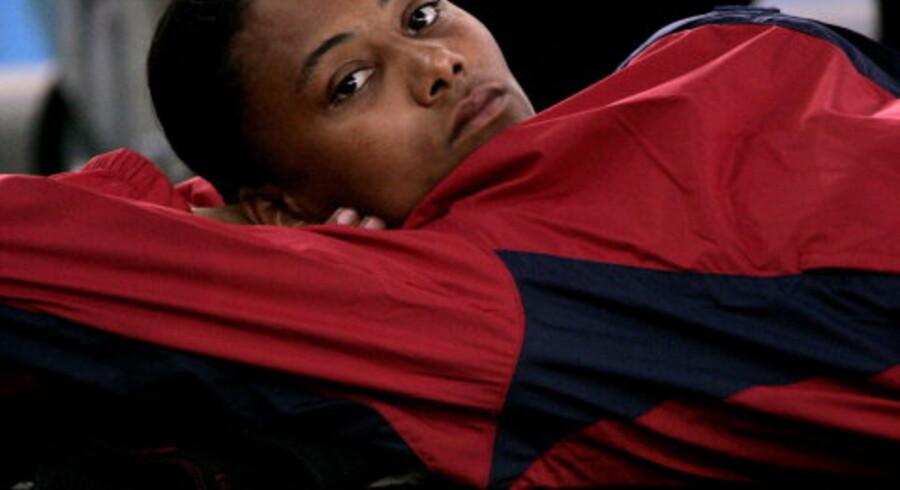 Marion Jones har grund til at se trist ud - ingen medalje i længdespring og koks i stafetten var hendes facit i Athen. <br>Foto: Ruben Sprich
