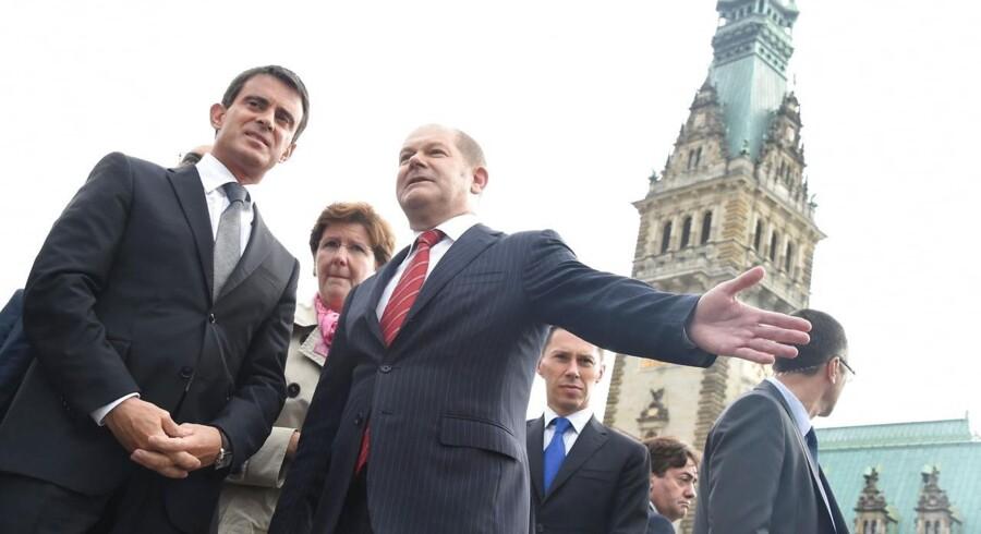 Den socialdemokratiske borgmester Olaf Scholz foran rådhuset i Hamborg.
