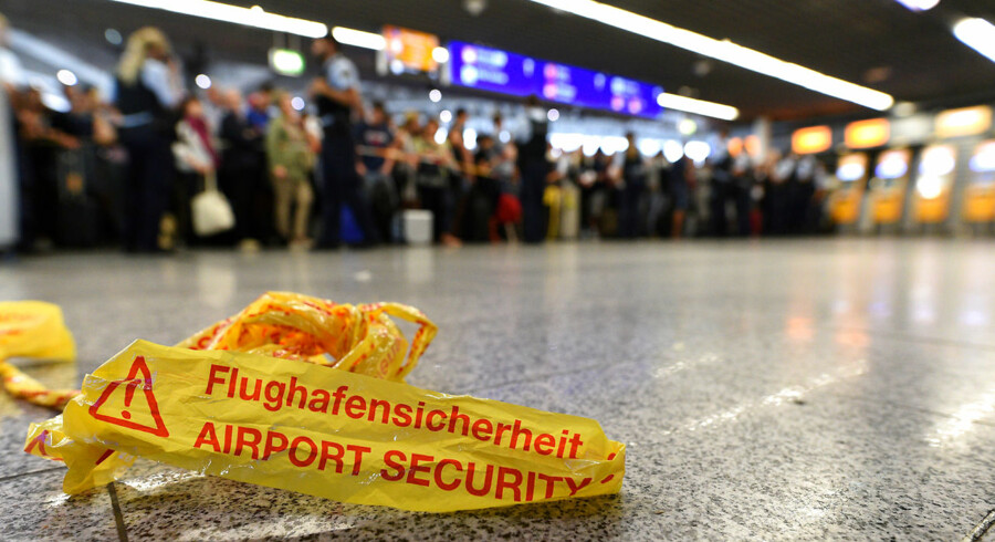 People wait in a terminal during the evacuation of Frankfurt airport, Germany August 7, 2018. REUTERS/Florian Ulrich NO RESALES.NO ARCHIVES.