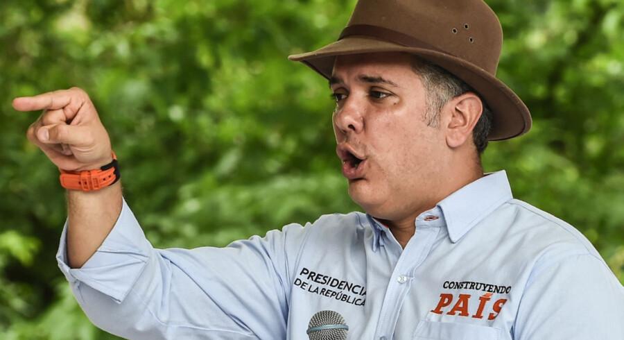 Colombias præsident, Ivan Duque, har afbrudt fredsforhandlingerne med oprørsgruppen ELN og kræver, at gruppen indstiller alle kriminelle aktiviteter, før forhandlingerne kan genoptages. Det afviser ELN. Joaquin Sarmiento/arkiv/Ritzau Scanpix