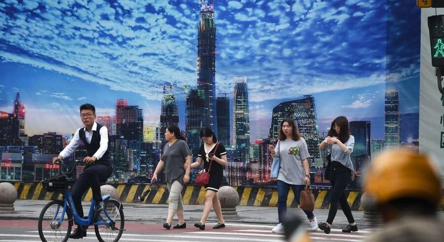 Der bygges meget i Kina i disse år, men landets økonomi ligger stadig langt efter f.eks. den amerikanske.