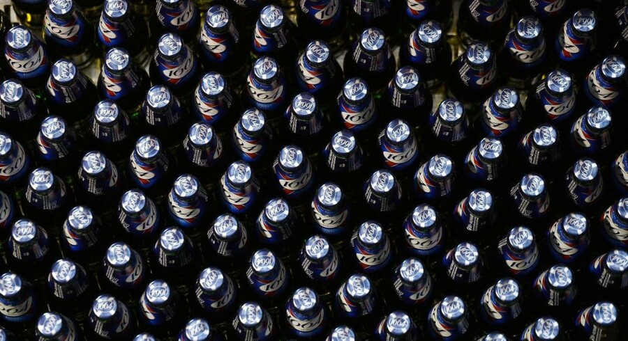 Bottles of beer are seen on the Kronenbourg brewer production line on December 12, 2014 at the main factory in the eastern French city of Obernai. AFP PHOTO / PATRICK HERTZOG