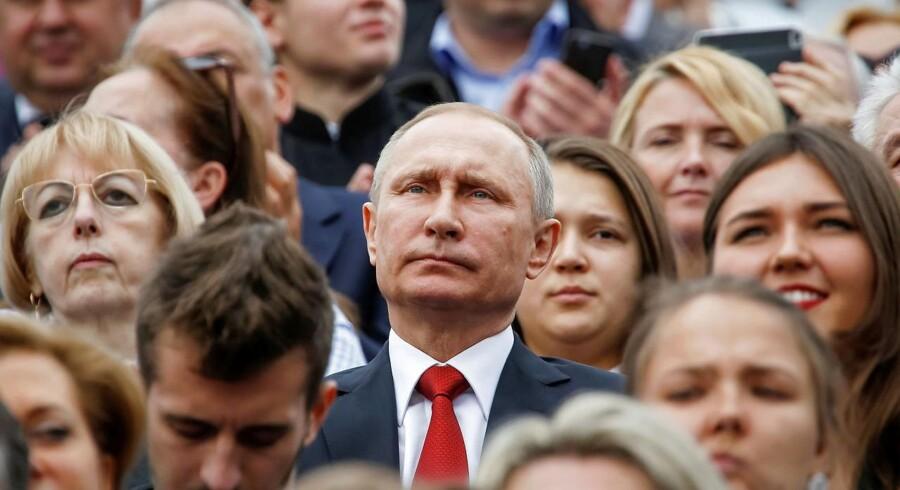 Den russiske præsident, Vladimir Putin, i selskab med moskovitter.