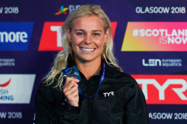 Silver medallist Denmark's Pernille Blume poses on the podium during the medal ceremony for the Women's 50m freestyle swimming final at the Tollcross swimming centre during the 2018 European Championships in Glasgow on August 4, 2018. Oli SCARFF / AFP