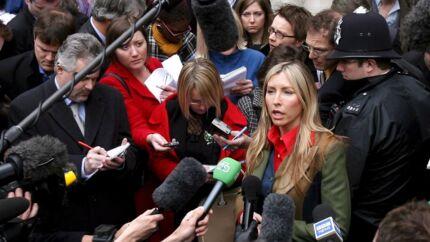 Paul McCartneys ekskone Heather Mills har fået tildelt et 'rekordhøjt' forlig i forbindelse med News of the World-skandalen.