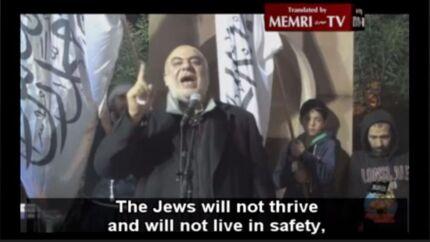Her ses Ismail al-Wahwah i 2014 ved et arrangement i den australske gren af Hizb ut-Tahrir, hvor hans prædiken blev oversat af Middle East Media Research Institute (MEMRI). FOTO: MEMRI